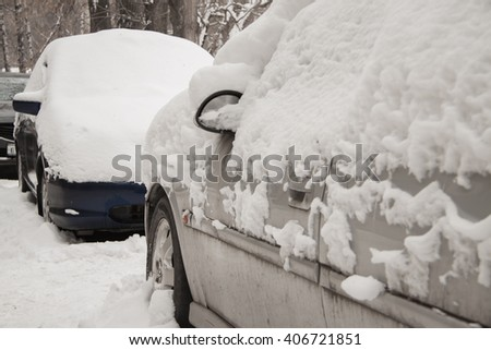 after a strong snow storm car covered in snow - stock photo