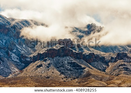 After a winter storm swept Chihuahuan Desert bringing snow to Chisos Mountains in Big Bend National Park, Texas, USA - stock photo
