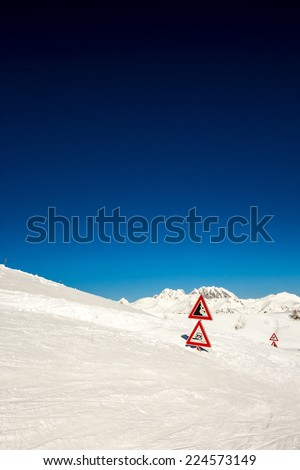 after an heavy snowfall the road is completely buried as the road signals - stock photo