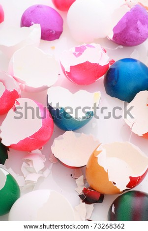 after easter scenario, colorful eggshells on white