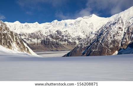 After Landing on the Pika Glacier in Denali National Park near Mount McKinley, View of the Kahiltna Glacier and the Alaska Mountain Range - stock photo