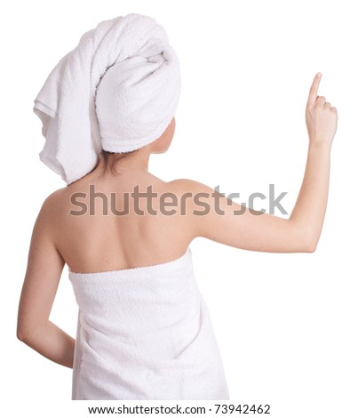 after shower - young woman in white towel on head pointing - stock photo