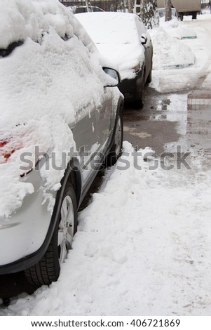 after  strong snow storm car covered in snow - stock photo