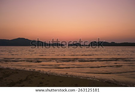 After sunset behind island at pakbara beach Thailand - stock photo