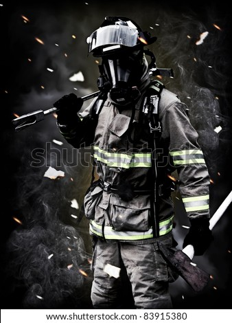 Aftermath , A firefighter Poses after a long fire fight with smoke,debris, and embers in the background. For more firefighter images please visit my profile. - stock photo