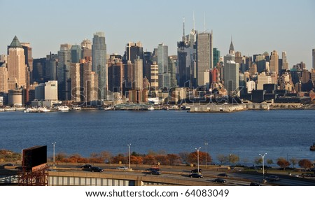afternoon capture of nyc skyline over hudson river - stock photo