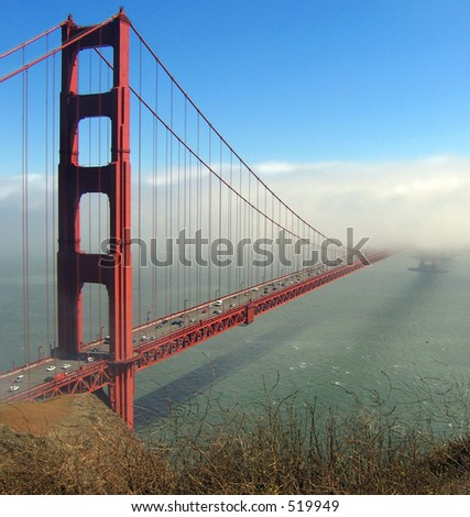 Afternoon fog obscures second tower of the Golden Gate Bridge - stock photo