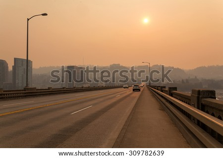 Afternoon Haze and air pollution on Ross Island Bridge in Portland Oregon due to forest wildfires - stock photo