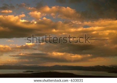 Afternoon storm over the lake - stock photo