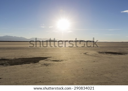 Afternoon sun at El Mirage dry lake in California's Mojave desert. - stock photo
