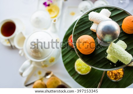 Afternoon tea ceremony, beach restaurant with sea view, flowers