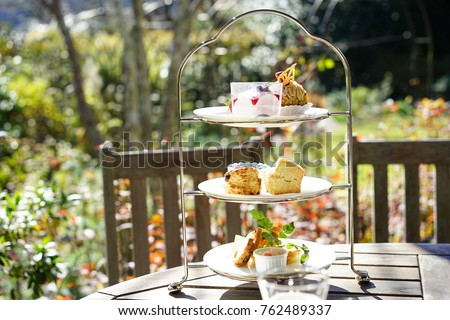 https://thumb7.shutterstock.com/display_pic_with_logo/167494286/762489337/stock-photo-afternoon-tea-in-a-terrace-762489337.jpg