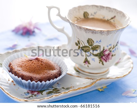 Afternoon tea served with a gourmet cupcake - stock photo
