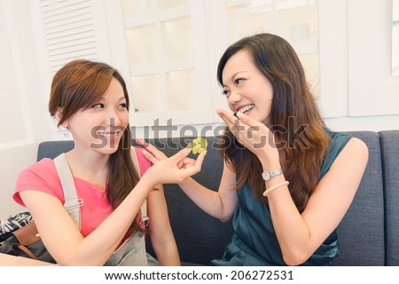 Afternoon tea time with friends in restaurant. - stock photo