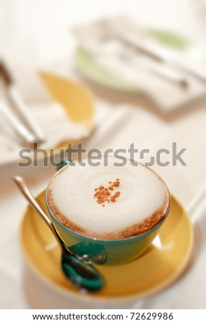 Afternoon tea with cup of coffee on desk in daytime. - stock photo