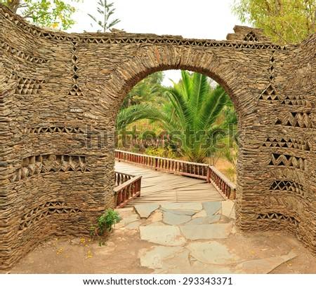 agadir city morocco Olhao Park stone ornamental wall fence - stock photo