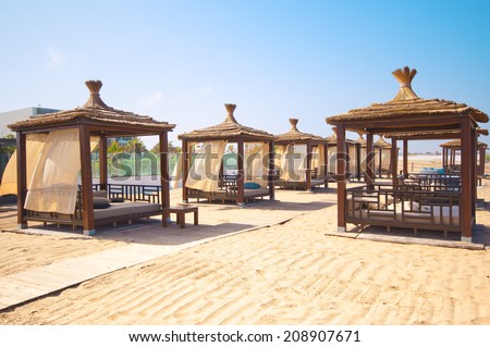 AGADIR, MOROCCO - JUL 08, 2014: Relax chairs at Hotel Sofitel Agadir Royalbay Resort is located in the magnificent beach of Atlantic ocean with golden sand and imbued  the spirit of modern luxury - stock photo