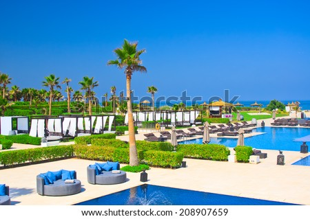 AGADIR, MOROCCO - JUL 04, 2014: Swimming pool  Hotel Sofitel Agadir Royalbay Resort is located in the magnificent beach of Atlantic ocean with golden sand and imbued  the spirit of modern luxury - stock photo