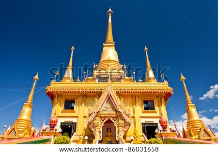 Against the backdrop of golden pagodas, beautiful skies of Thailand. - stock photo