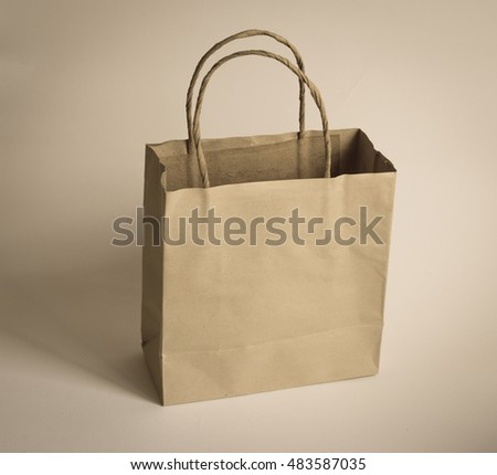 Age photo of Brown paper shopping bag isolated on white, Brown Shopping Bag with Handles Isolated on White Background