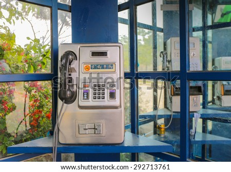 Aged and vintage photo of old public phone booth  - stock photo
