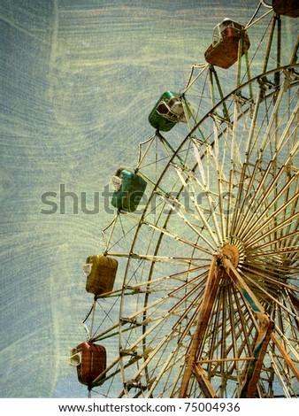 aged and worn photo of ferris wheel - stock photo