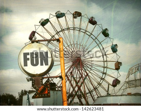 aged and worn vintage fun sign with ferris wheel