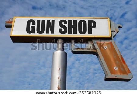 aged and worn vintage gun shop sign                             - stock photo