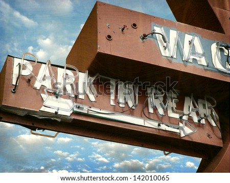 aged and worn vintage neon sign - stock photo