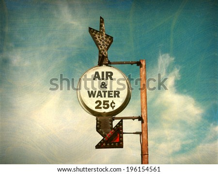 aged and worn vintage photo of  air and water sign                              - stock photo