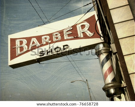 aged and worn vintage photo of barber shop sign - stock photo