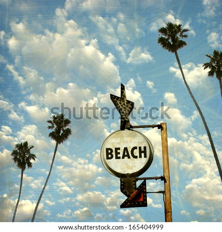 aged and worn vintage photo of beach sign with palm trees - stock photo