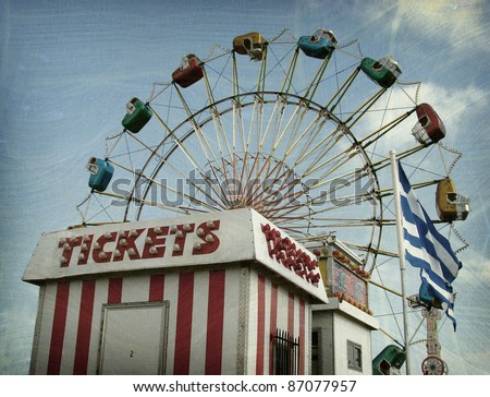 aged and worn vintage photo of carnival ride and ticket booth - stock photo