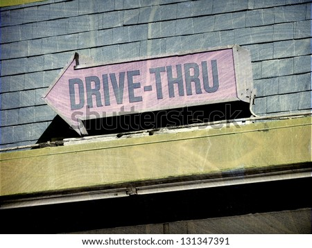 aged and worn vintage photo of  drive thru sign - stock photo
