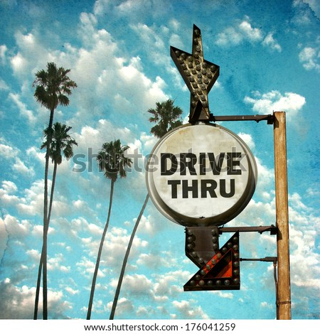 aged and worn vintage photo of drive thru sign with palm trees - stock photo