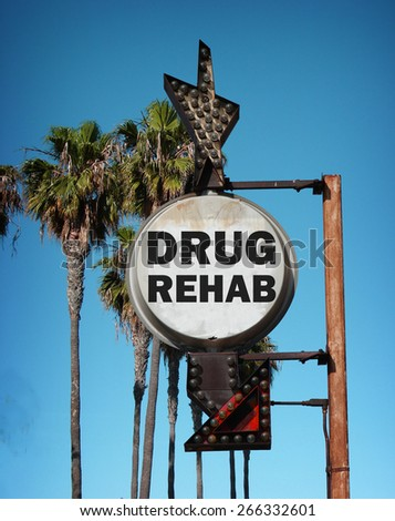 aged and worn vintage photo of drug rehab sign with palm trees                              - stock photo