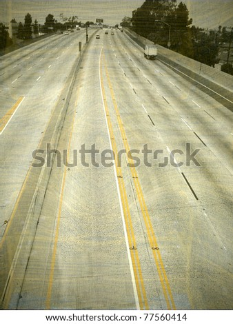 aged and worn vintage photo of empty freeway - stock photo