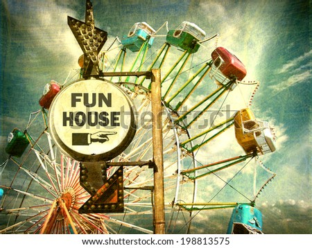 aged and worn vintage photo of fun house sign with ferris wheel                                - stock photo