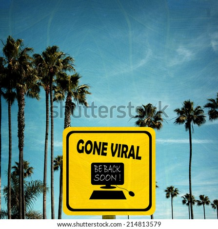 aged and worn vintage photo of gone viral sign on beach with palm trees - stock photo