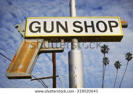 aged and worn vintage photo of gun shop sign                                - stock photo
