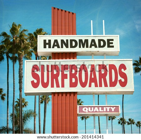 aged and worn vintage photo of handmade surfboard sign on beach - stock photo