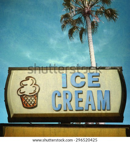 aged and worn vintage photo of ice cream sign and palm tree                               - stock photo
