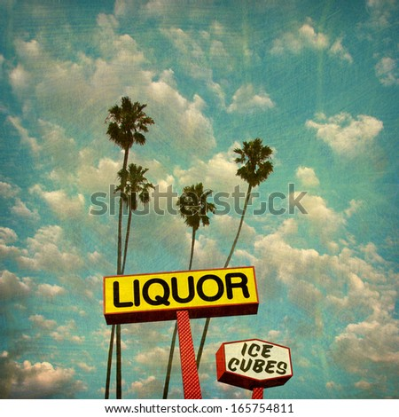 aged and worn vintage photo of liquor sign and palm trees - stock photo