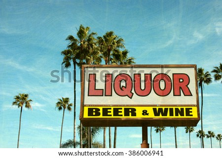 aged and worn vintage photo of liquor sign and palm trees