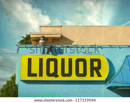 aged and worn vintage photo of liquor store sign