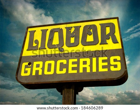 aged and worn vintage photo of liquor store sign                                - stock photo