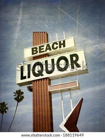 aged and worn vintage photo of liquor store sign with palm trees - stock photo
