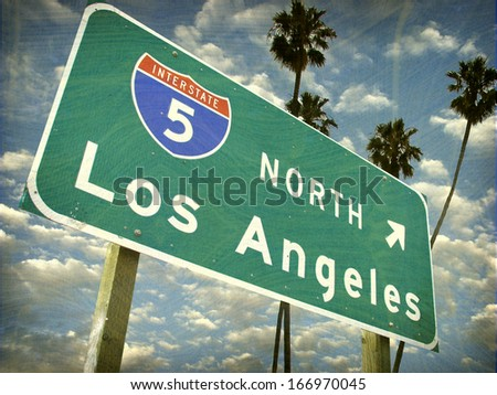 aged and worn vintage photo of los angeles sign with palm trees                               - stock photo