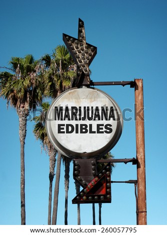 aged and worn vintage photo of marijuana edibles sign with palm trees - stock photo