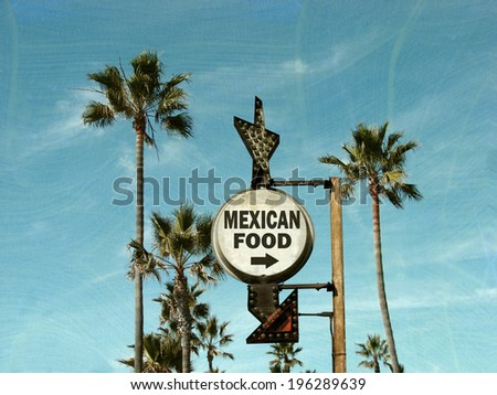 aged and worn vintage photo of mexican food sign with palm trees                - stock photo